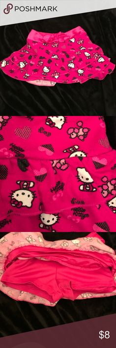 Pink Hello Kitty skirt Pink ruffled Hello Kitty skirt. Hello Kitty, poodles and hearts on skirt. Satin waste band with bow. Satin shorts under skirt Hello Kitty Bottoms Skirts