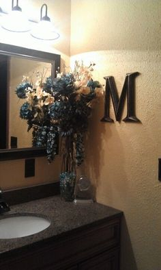 Blue yellow and brown bathroom decor