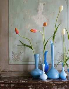 Beautiful tall blue vases with tall Blooms. Stunning.