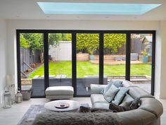 Check out this modern extension with bifolding doors - it's beautiful! Photo credit: Rachael Casey