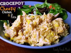 Crockpot Cheesy Chicken & Rice With Yellow Rice, Boneless Skinless Chicken Breasts, Shredded Cheddar Cheese, Onions, Cream Of Chicken Soup, Corn, Chicken Stock