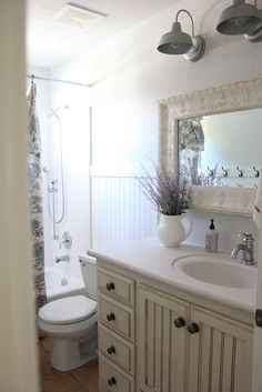 {Primp}: french farmhouse bathroom ~ Love the mirror and the lighting. Also love the white pitcher with the lavender.