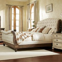 Monroe King Bed in Baroque Sleigh bed with button-tufted upholstery and turned bun feet.