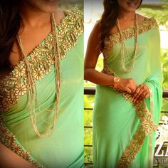 Light green saree with golden patch work for border. Zari.