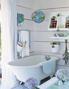 Not sure what all those little jars are filled with- but I like this for the 3rd floor bathroom. I like the pail as a way to organize bath toys.