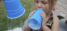 Poke a hole in the bottom of a cup, then dip the top in the bubble solution, and blow big bubbles!