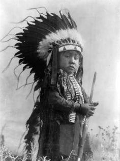 """Little Crow Indian - 1907..He has that """"You talkin' to me?"""", stoic look, even at a young age. How cute! Crow people were known for their beadwork and tremendous horsemanship. The woman rode as well as the men. That wasn't the case with most tribes."""