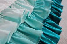 Loving this blue ombre ruffle crib skirt - DIY    {YOU DON'T HAVE TO RUFFLE BY HAND! adjust stitch to the longest length, and tension to highest and sew a straight stitch to create effortless ruffles!}