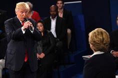 Caption: Donald Trump addressing Hillary Clinton during the second presidential debate on Sunday in St. Louis.