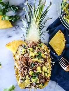slow cooker jerk pork in pineapple rice bowls I howsweeteats.com