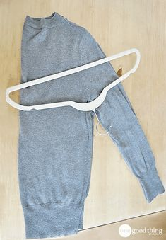 Even the most expensive hangers can result in wrinkles and creases. Learn how to hang a sweater without causing unsightly stretching or shoulder bumps.