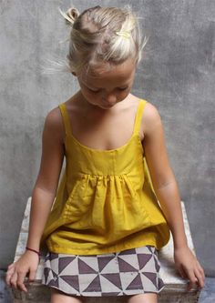Bondville: Stylish Kids: Udder  this top reminds me of the Swingset  Tunic by Oliver and S. Cute in pretty yellow.