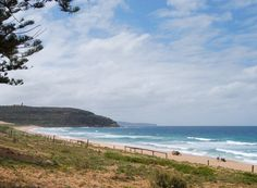 Palm Beach looking north - The lighthouse is at the top of Barrenjoey Head