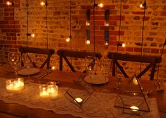 Festoon cascade top table backdrop, lace table runner, brass terrarium lanterns, rustic trestle table and crossback chairs for a rustic barn wedding at Upwaltham Barns by www.stressfreehire.com #venuetransformers