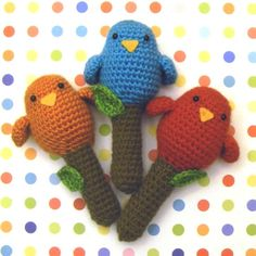 Crocheted baby rattles! Made this without the bird parts. My grandson thinks it's a microphone and sings into it.
