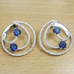 Massjewelry - Brilliant Cut Micro Setting Blue & White CZ 925 Sterling Silver Rhodium Half Moon Hoop Earring
