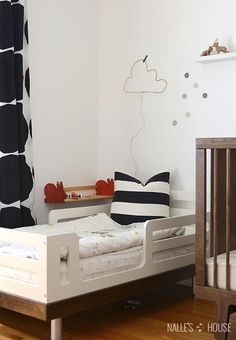 A Bedroom Nook With DIY Wire Cloud Night Light Hanging On The Wall Cute Functional 5 Projects That Look Good Make Life Better Kids