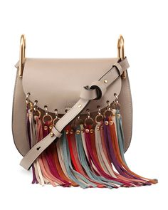 5655995d684 Chloe small shoulder bag in smooth calfskin leather. Brass hardware with  pale golden trim. Flap top with snap closure. Multicolor suede fringe at  front.
