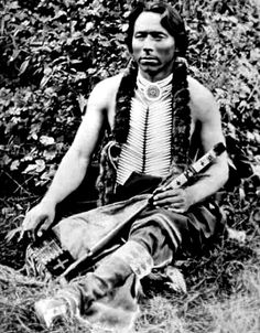 Omaha man seated holding a pipe. Photo: No date.