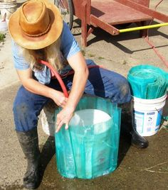 Filling a Wall O Water Greenhouse from a hose using a 5 gallon bucket to make filling easier