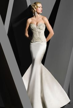 Strapless satin mermaid gown, with pearl and jeweled bodice.  Brides