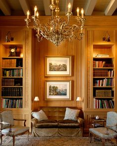 The library is directly off of the grand salon in an identical, but symmetrical, position as the dining room. The room is paneled in culled and matched sinker cypress wood from Louisiana swamps. The beams are painted to match the rest of the home, typical of Creole houses. The prints are original Currier and Ives that depict steamboats on the Mississippi River.