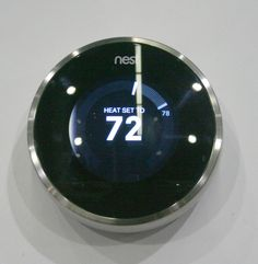 Most thermostats are pretty ugly and hard to program, leading to energy waste. @Nest 's simple design and self-programming make saving energy look good. Found at LA's Dwell on Design 2013 #dod2013 #dwellondesign