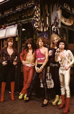 Glam Rock Fashion - a style of the 70's, David Bowie and other musicians adopted androgynous costumes with ornate details and fabrics, accessories such as feather boas and platform shoes, and dramatic makeup