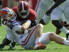 Alabama defensive back Tony Brown (2) stops Florida quarterback Jeff Driskel (6) at Bryant Denny Stadium in Tuscaloosa, Ala. on Saturday September 20,  2014.