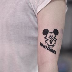 Distorted Mickey Mouse face and words 'who cares' inked on the left arm Unique Forearm Tattoos, Cool Arm Tattoos, Body Art Tattoos, Tattoos For Guys, Tattoos For Women, Tatoos, Mickey Tattoo, Mickey Mouse Tattoos, Mini Tattoos