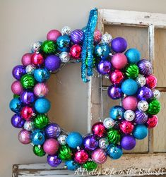 I have become a big fan of Wreath embellishing and would love to hit up some christmas sales at the end of the season and pic up a large number of christmas balls to creat this wreath... maybe even check craiglist for people  who are getting rid of their ornaments, to make one on the cheap