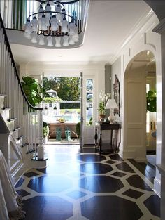 Two story foyer chandelier painted floors pattern