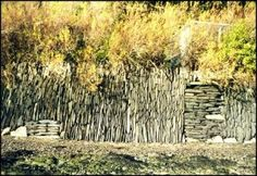 Vertical stack stone wall- super cool; I might like different plantings, less delicate, to contrast with the intricate stone work