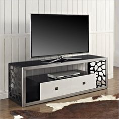 A metal TV stand will be sturdy, more lightweight than wood, and have a potentially slimmer profile. These models can often be shaped into novel configurations, and feature unique patterns and cuts. The most modern units often feature metal in the construction, whether alone or with glass shelving.
