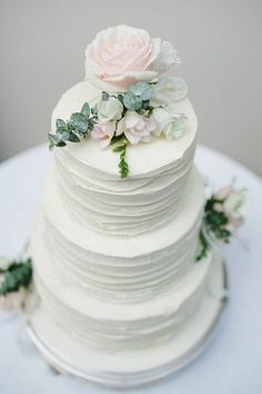 White four-tier wedding cake with pale pink roses | image by Jason Mark Harris