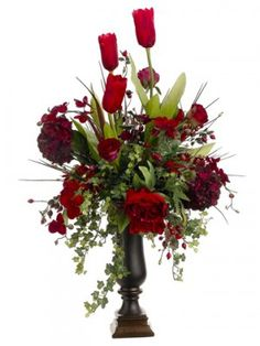 Place this glorious and outstanding vase filled with Tulips, Roses, and Peonies on a foyer table, accent table, dresser, or buffet.  The rich burgundy red roses in our silk floral design will add a touch of elegance to any room in your home.  High quality tall urn is made on resin.  Silk flower arrangement measures 40x24x24