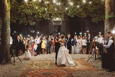 """""""We should probably talk about how utterly perfect this moment is... The festoon lighting, the guests with sparklers, the way he looks at her, the…"""""""