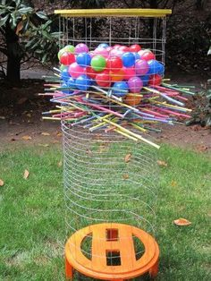 Ker Plunk Game: Pull sticks and if the balls fall, you are the loser.