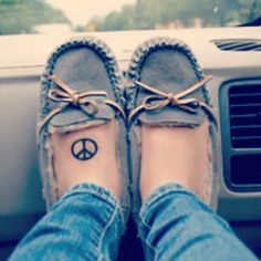 A peace sign tattoo would be cool. Maybe not on my foot though. That's too Christofer Drew :P