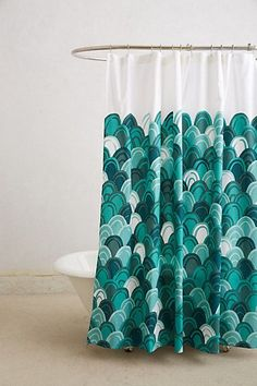Love this color in a bathroom. So fresh and yet reminiscent of the mediterranean. Emerald Shells Shower Curtain