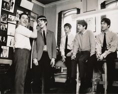 The Beatles and a tailor in 1964. Getting ready for the Ed Sullivan Show.