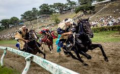 Samurai horsemen compete in the Kacchu-keiba (armed horse race) during the Soma Nomaoi festival at Hibarigahara field in Minamisoma, Japan  //  Picture: Chris McGrath