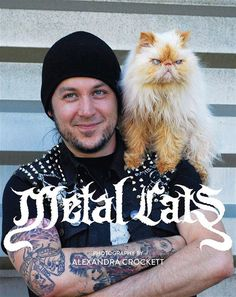 METAL CATS, (photos Of Heavy Metal guys with their cats). I'm so conflicted over what board to put this on