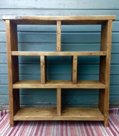 Multi-functional storage unit handmade from reclaimed scaffold boards, ready for immediate dispatch.  This unit can be used as storage, or to display items, as a book shelf or for whatever you choose.  The boards used have lovely details within the timber and maintain an industrial look with some of the original metal components kept. Length: 95cm / Height: 98cm / Depth: 22.5cm  Hole sizes: 39.5cm / 39.5cm  25cm / 25cm / 25cm  39.5cm / 39.5cm  The shelves are all...