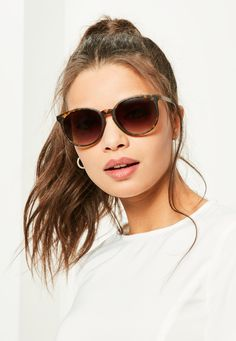 Keep the haters away with these brown tortoise shell club sunglasses.