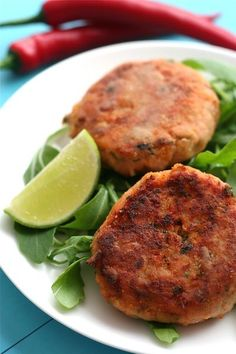 sweet potato and salmon fish cakes  1 lb 2 oz (500 g) sweet potatoes  2 x 7 oz (200 g) cans of salmon  1 red chilli, finely chopped  zest and juice of 1 lime  a handful of fresh cilantro (coriander), chopped  salt and freshly ground black pepper  1 cup (120 g) flour  1 egg, beaten  1 cup (100 g) dried breadcrumbs  olive, vegetable or rapeseed oil  lime wedges [use coconut oil]