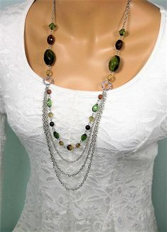 Long Multi Strand Silver Chain, Green and Brown Beaded Necklace, handmade by Ralston Originals. This beaded necklace has green, and brown beads, in glass and acrylic. The acrylic beads make the necklace lightweight and comfortable to wear. The multi strands of chain are silver
