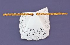 Easy Angel Crafts Doily Paper Angel step 12 insert second half of chenille wire through punched holes