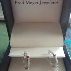 Genuine Ruby and Diamond Hoop Earrings~ Make Offer Overview  These wonderful fashion earrings feature square cut rubies and round brilliant diamonds set in a 10 karat white gold hoop style. These earrings are a great complement to any outfit that needs some sparkle and a hint of color. Jewelry Earrings