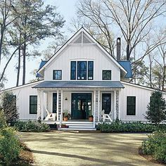White Plains | Create a place where tradition can endure, here's a casual cottage with Folk details such as latticed porch columns, a steeply pitched roof and exposed rafters. A twist of Carpenter Gothic style, the home is accented with board and batten siding and a metal roof which lend a playful, vernacular feel. | SouthernLiving.com